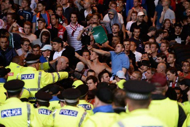 Police step in as Ajax fans react angrily